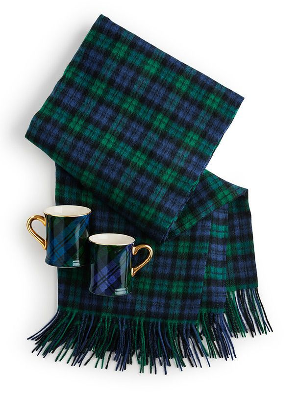 A warm wool blanket gets a season-right makeover in a blue-based tartan plaid with cute mugs to match - the perfect gift set.