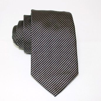 Jacquard tie, 100% silk, dark grey with oblique white stripes. Ideal for less formal occasions but also special occasions. Pattern and color of this elegant tie can fit with any outfit