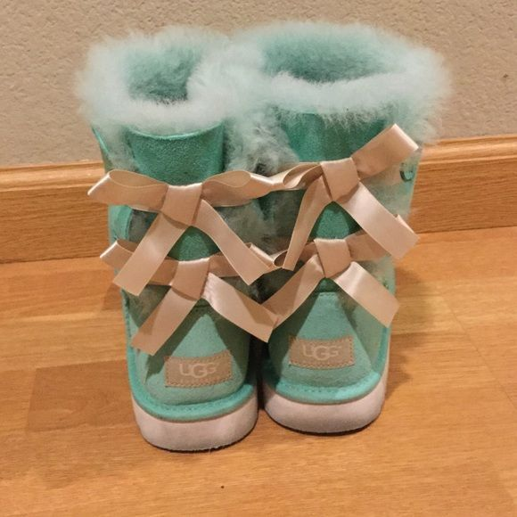 Tiffany Uggs Only willing to part for the right price. Totally adorable looking like a Tiffany box. I've worn these only a few times so they are still fluffy inside. Ugg short boots in Tiffany Blue color with white bows. Kids size 5, fits women's size 7. I'm a 6.5 in Women's and these are a perfect fit! UGG Shoes Winter & Rain Boots