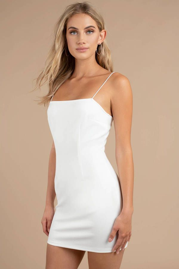 2055e053d8611 Get ready for all your late night plans with the Angie White Bodycon Dress.  This sexy clubbing dress features a classic bodycon fit #shoptobi