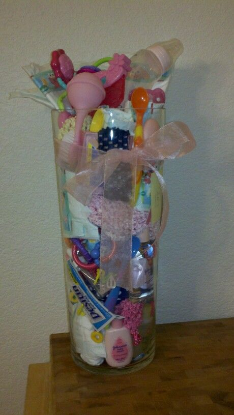 Baby shower game...guess how many baby items in the vase. Great for large baby showers because people can place their guess as they are walking in the door.