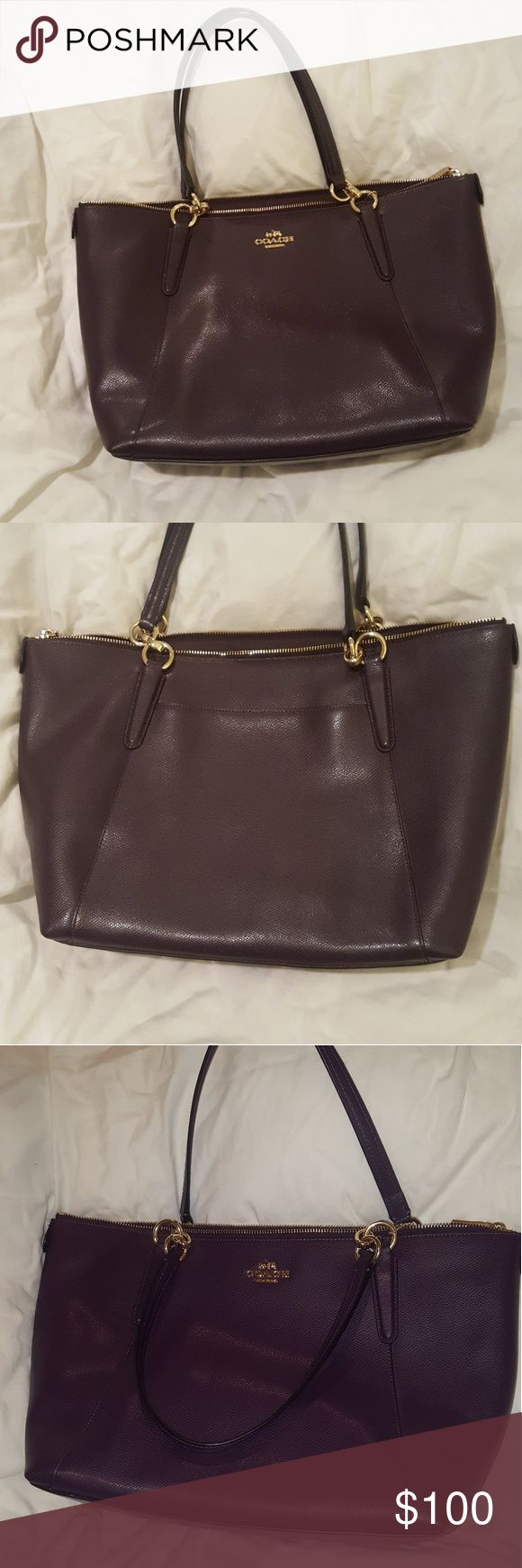 """Like new Coach handbag/purse Beautiful dark purple/eggplant color with gold accents. 17"""" wide by 11"""" tall with a handle drop of 8"""". Like new condition, no marks or blemishes. Coach Bags Shoulder Bags"""