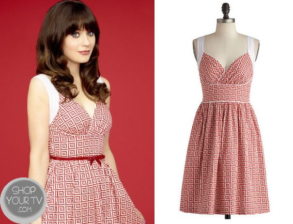 Jess Day (Zooey Deschanel) wears this red printed patterned dress in the promo picture for Season 3 of New Girl. It is the Modcloth Paradise Tile Dress.  Buy it HERE