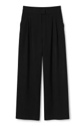 <p>The Iris Trousers are a pair wide pants with loose-fitted legs and pleats at waist for a neat look. The waist is elasticated at the back for a comfortable fit.</p><p>- Size 38 measures 74 cm in waist circumference when relaxed and 80 cm when extended. The inseam measures  74,50 cm in length.</p>