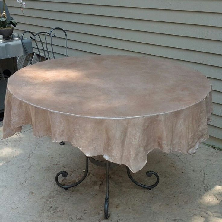 Concrete table cloth. I LOVE THIS! I have the perfect outdoor table bottom to use