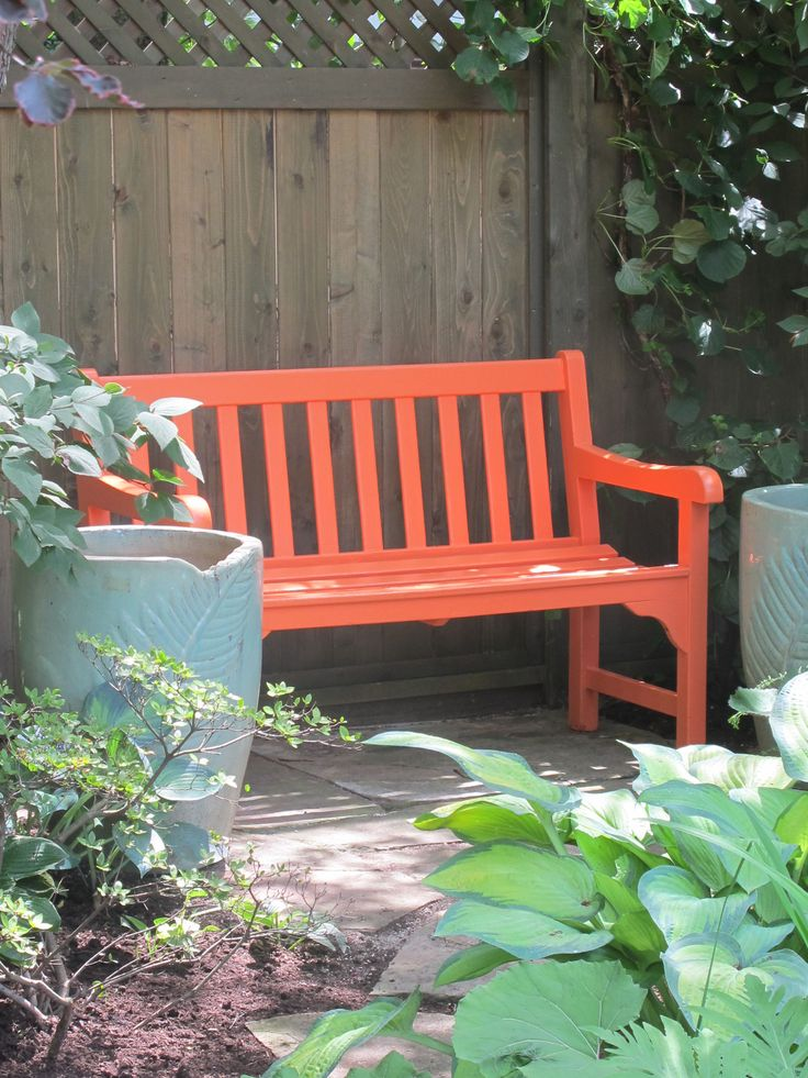 tangerine bench between blue pots