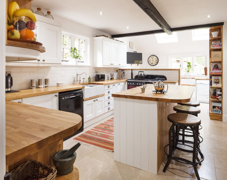 This large country kitchen was refurbished using a wide range of our oak kitchen units, solid oak worktops and beautiful Traditional frontals hand-finished in Farrow & Ball's All White. The kitchen island combines additional storage space with a breakfast bar that makes this kitchen as social as it is functional. http://www.solidwoodkitchencabinets.co.uk/gbu0-display/solid_wood_kitchen_cabinets.html