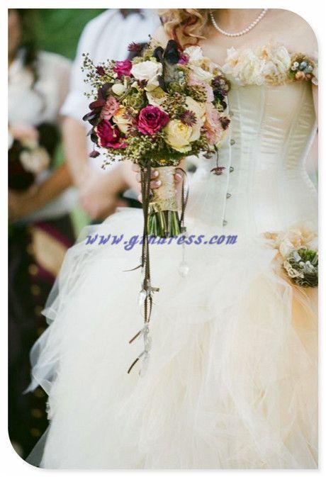 vintage wedding dress with vintage wedding bouquet.