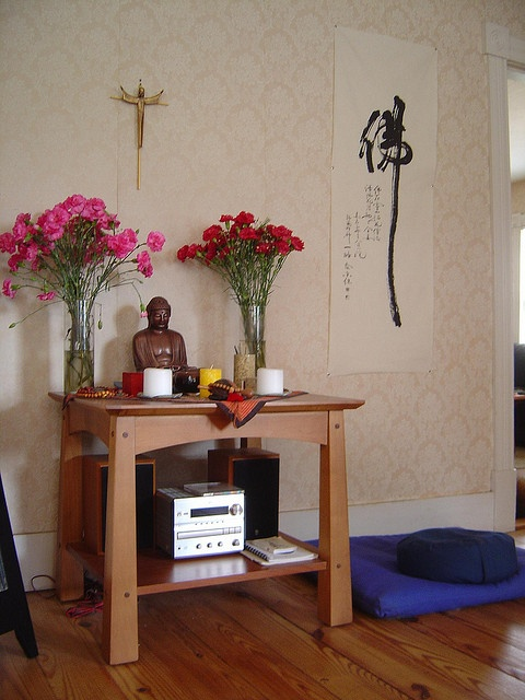 Buddha altar with crucifix by Lorianne DiSabato, via Flickr