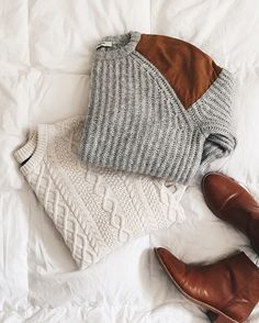 Sweaters galore. White and grey + camel. We love both.
