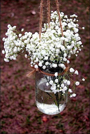 flowers in jar for aisle