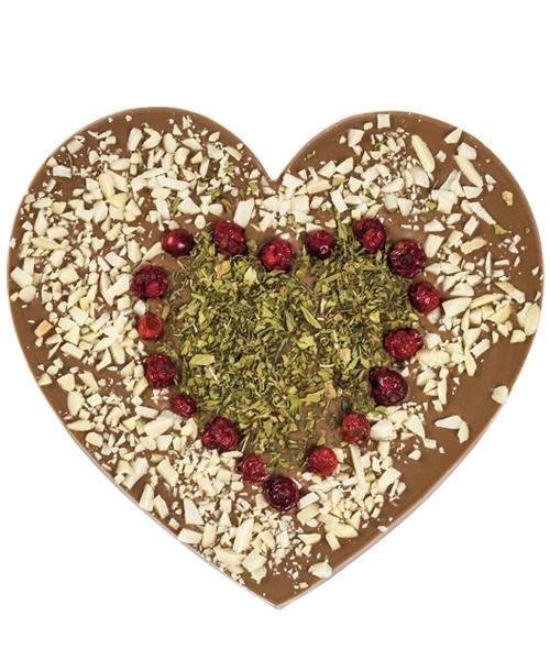 """CZEKOLADA MLECZNA Z LUBCZYKIEM Duże serce wykonane z delikatnej mlecznej czekolady z dodatkiem chrupiących migdałów, suszonej porzeczki i """"miłosnego"""" lubczyku."""