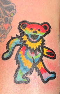 grateful dead dancing bear tie dye tattoo by jeb maykut at flyrite tattoo in williamsburg, brooklyn