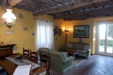 Ground floor of Casa Uva, large living with dining area, opening onto the front terrace with great view, garden, satellite TV.