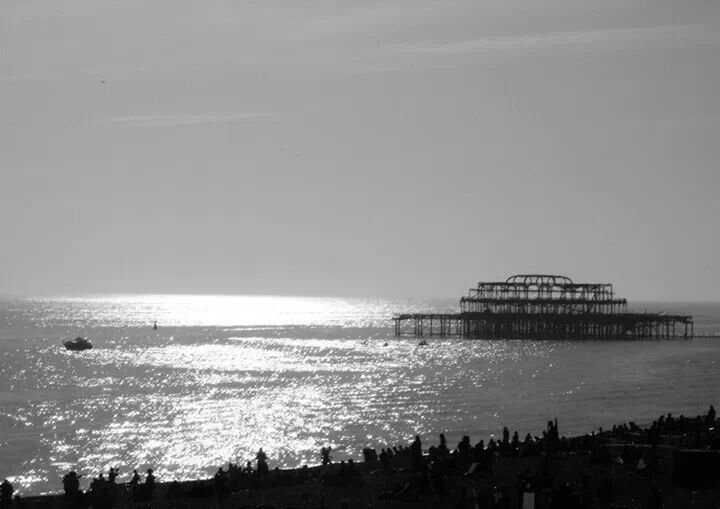 The west pier and busy beach