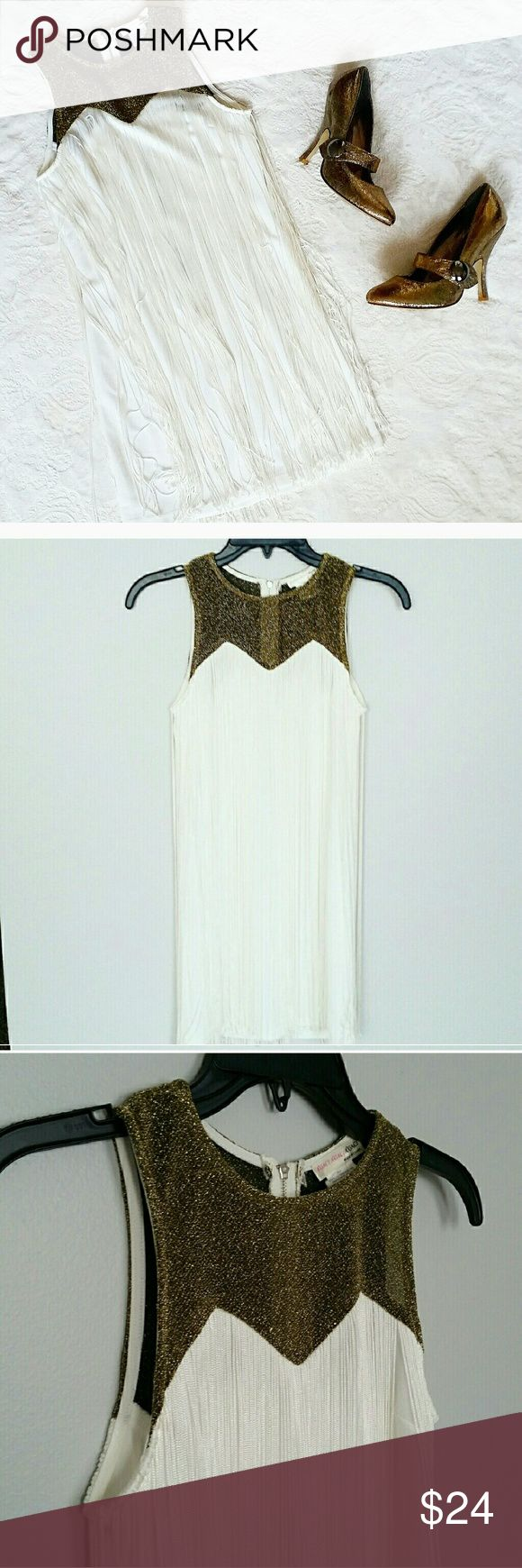 EUC Boho Fringe White and Gold Bodycon Dress EUC Boho Fringe Bodycon Dress EUC worn once. Boho style Bodycon dress material details on photos. Dress body is white stretch material, overlaid with white Fringe that goes down to hem. Gold top is non-itchy material. Silver zipper back closure. Armpit to armpit 14 inches, neck to hem 27.5 inches, width 15 inches at hem. a'gaci Dresses Mini