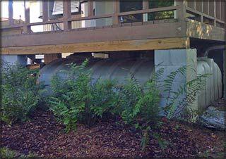 Modern Cisterns & Rain Harvest Technology, hidden under the back deck.  I love this solution.
