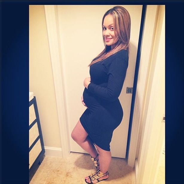 """Basketball Wives star Evelyn Lozada is pregnant! She announced her pregnancy — without revealing the baby's father — yesterday through People, saying """"I am so excited to announce a wonderful blessing — I'm pregnant!"""" She is six months along.  Evelyn posted the photo above to Instagram with the caption """"New Beginnings."""" Scroll below for another photo of Evelyn's baby bump!"""