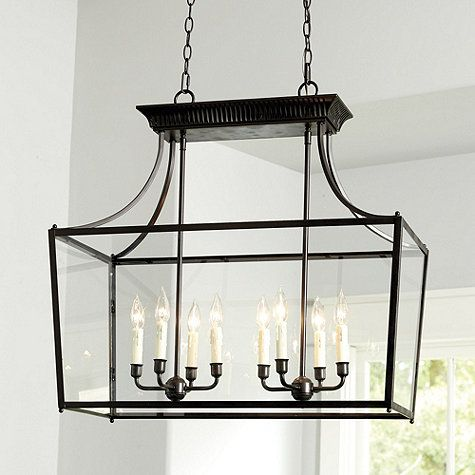 The Sheffield Eight Light Chandelier is just as perfect over a kitchen island and as it is in the dinning room. It's classic silhouette is highlighted by a vented crown and ball details. Crafted of metal with bronze finish.Sheffield 8-Light Chandelier features: Cream drip candle sleevesBall detailsOpenwork crown