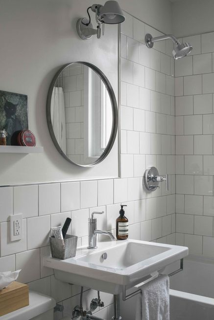 "To cut costs in the bathroom, the tiles are ""the cheapest wall tiles from Home Depot,"" capped with a Quadec Schluter finish."