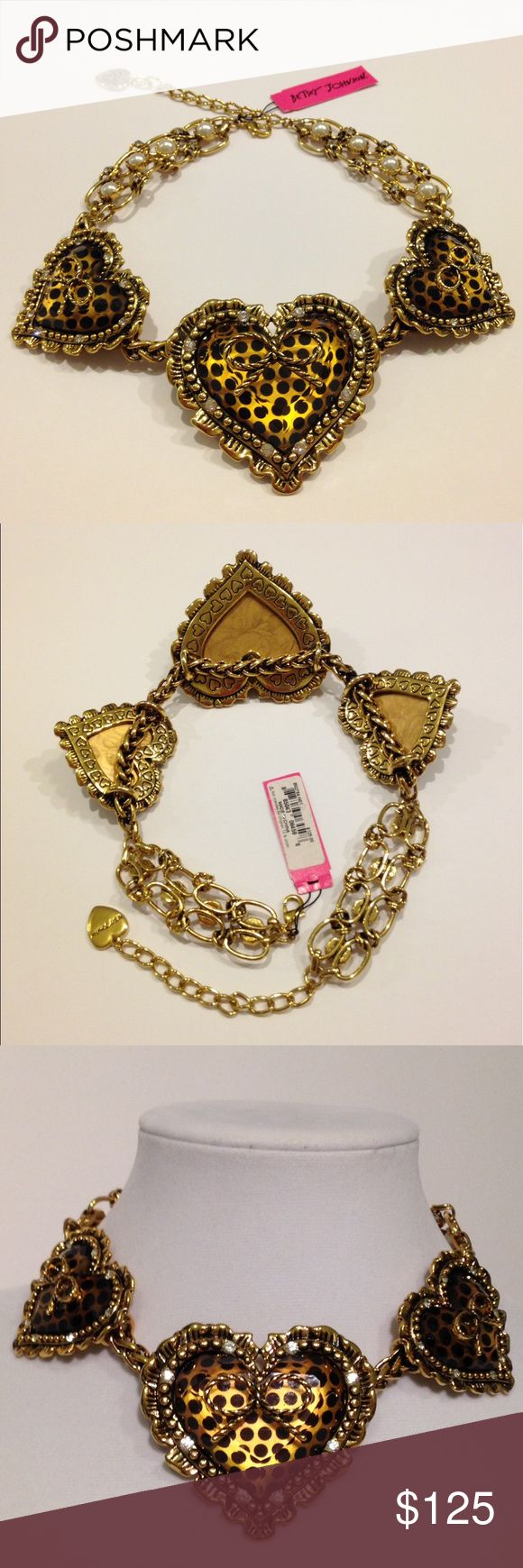 Betsey Johnson Leopard Polka Dot Heart Necklace 100% Authentic vintage retired Betsey Johnson gold and black polka for heart necklace. (It reminds some people of leopard print, but it is polka dots). Lucite hearts with gold bows on front, and gold and black polka dotted background. The hearts are surrounded by a gold embellished ruffle frame, along with crystals. There are not crystals or pieces missing. No tarnishing. Comes with original plastic manufacturer bag. Substantial piece. Has some…