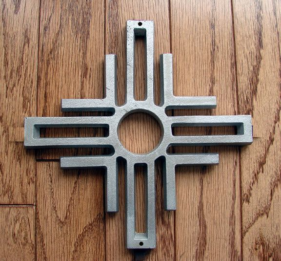 """A true southwestern symbol Perfect for centerpiece on gates, walls and doors Made of solid cast aluminum Measures 10"""" x 10"""" x 1/2"""" thick Includes mounting screws Available in Unfinished, Black PC or D"""