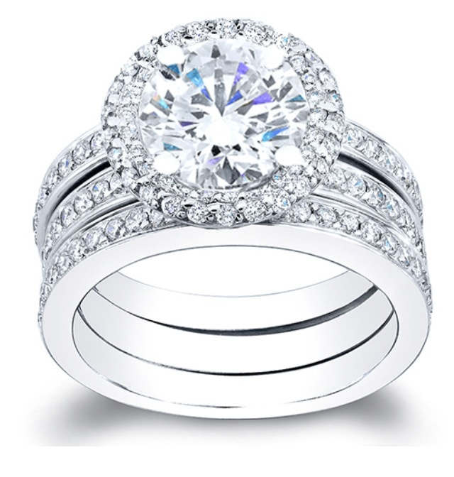 Something to this style would be amazing but my center stone as a white sapphire (6mm in diameter) <3