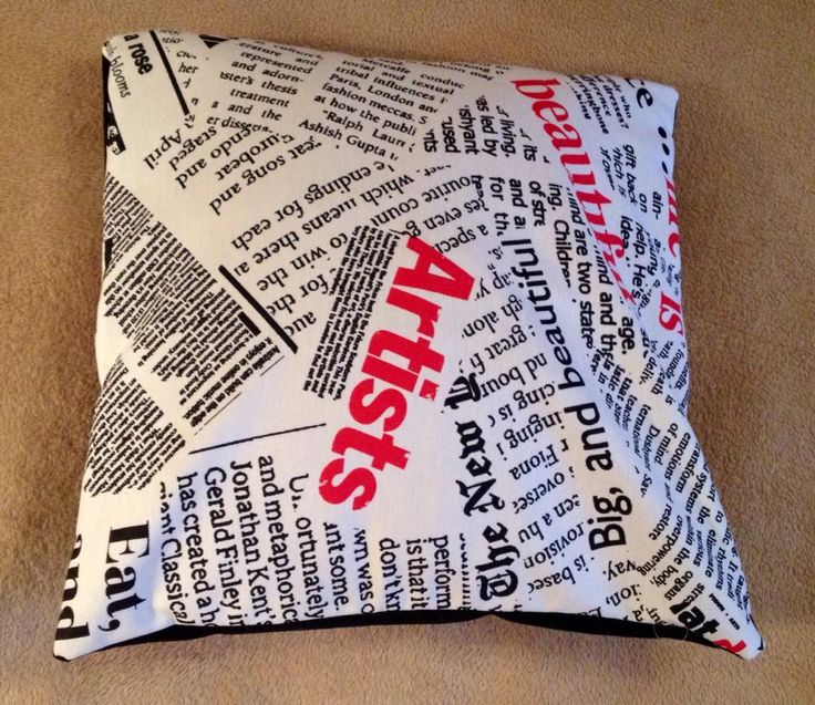 Handmade throw pillows. Set of two: Newspaper print with black and red back, respectively. Materials: Creton and velvet. Pillow inserts included. Made to order.