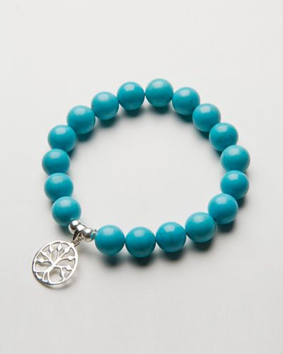 TURQUOISE CHARM BRACELET $38.00  This beautiful bracelet is handcrafted with stunning turquoise howlite stone and finished with a sterling silver beads on a high quality stretch transparent elastic. Howlite turquoise is a turquoise stone that has erratic streaks that appear like cracks throughout the stone often in browns, greys or blacks.