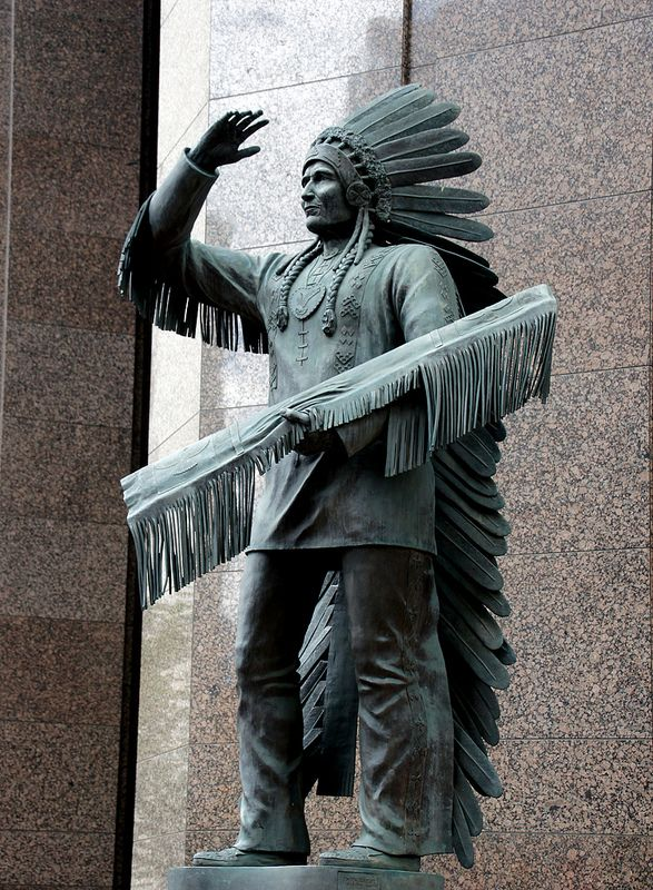 ˚This statue is of Sitting Eagle or John Hunter is located on the corner of 7 Avenue and 6 Street SW in downtown Calgary, Alberta.