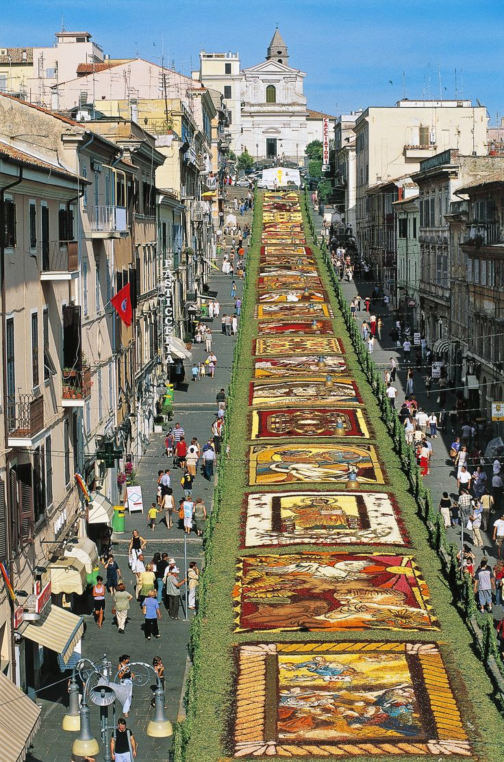 Genzano Infiorata, Genzano di Roma, Italy -- Every year since 1778, Genzano di Roma, about 20 miles s/e of Rome, hosts a massive flower festival. An elaborate blooming carpet arranged in detailed designs covers Via Italo Belardi in the center of the town, drawing thousands of spectators. This year's festival will take place May 28 to 30 -- photo, DeAgostini, Getty -- Architectural Digest -- 4-12-16