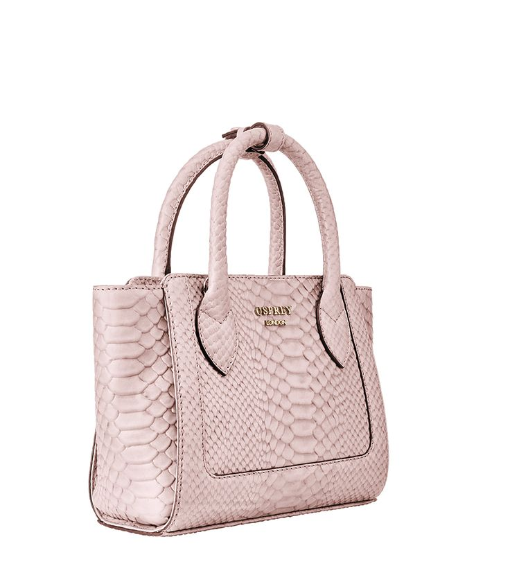 OSPREY LONDON. The Darcey Leather Grab, in Blush Pink. Made in supple cowhide embossed with an anaconda print in soft blush and hand-finished with dark edge stain for a look that's feminine yet tough, this cute little handbag with a fashionable batwing shape has two rolled leather carry handles with a leather keeper. £245 https://www.ospreylondon.com/products/the-darcey-leather-grab