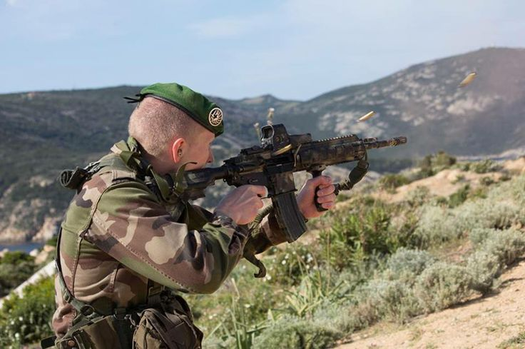 French Foreign Legion 2REP commando fires HK416 assault rifle while training with CPA 20.