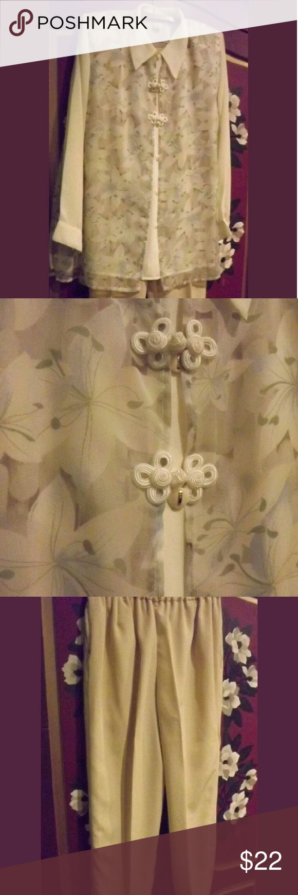 """Pants Suit by MERMAID Sz L Gorgeous! This is a gorgeous pants suit for either mother of the bride or Sunday brunch with the girls. It is 100% polyester and very flattering in design. The top is a bit sheer but has two layers of fabric...top one is floral and underside is solid ivory color. Bust measures 42"""" and hips are 43-44""""...pants measure 28"""" in waist (has a flat panel in front of waist with zipper and elasticized in back) without stretching the elastic. The inseam is 28"""" but has 2"""" hem…"""
