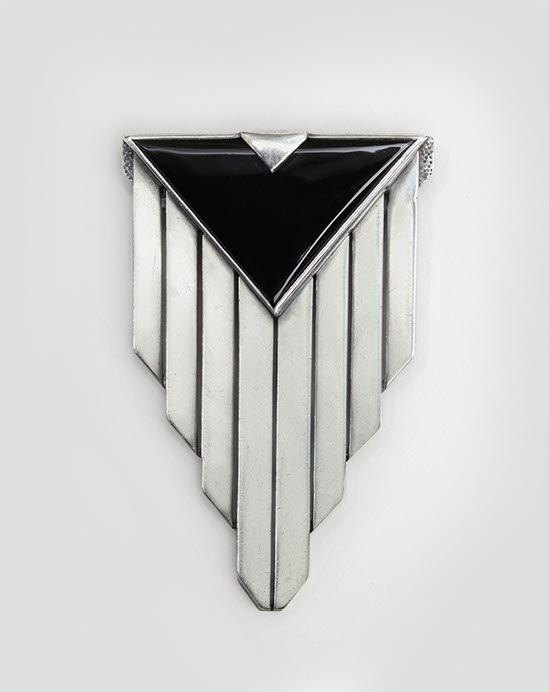 """PENDANT by Jean Després (1889-1980) France, circa 1929 Length: 3"""" - Width: 2"""" Silver and onyx pendant in a cubist design with a triangle of black onyx above eight silver panels. Later transformed into a brooch. Hallmarks: 950 silver/ signed J. Despres"""