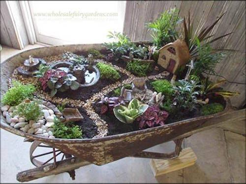 Here's another succulent garden idea (see the slide before this). Its a Wheelbarrow Succulent Fairy Garden made by Wholesale Fairy Gardens. Neat!