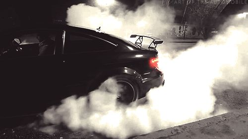 Race car burning rubber gif. Luxury Italian car spinning tires and burning the rubber with a huge white smoke cloud. Reaction gifs