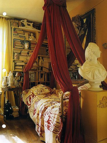 Book lover's bedroom w/ red canopy