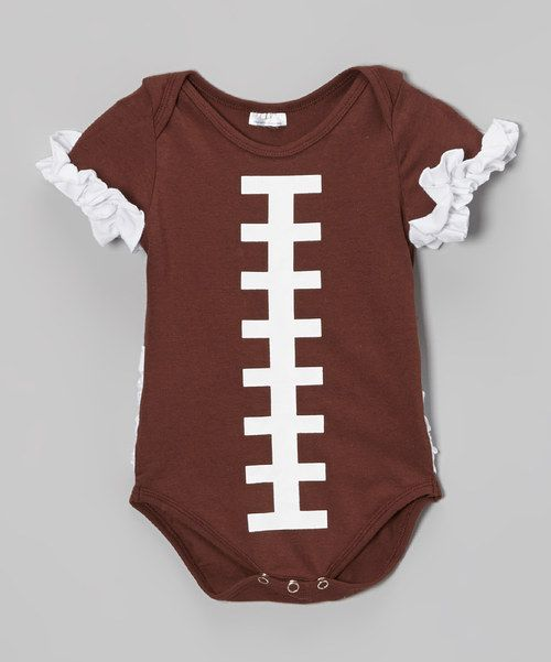 They may not be able to toss around the old pigskin yet, but little darlings can still be sporty! With a clever football design and sleeves adorned with ruffles, this bodysuit is athletically adorable. A handy lap neck and snap bottoms make it a changing time MVP.Cotton / spandexMachine washMade in the USA