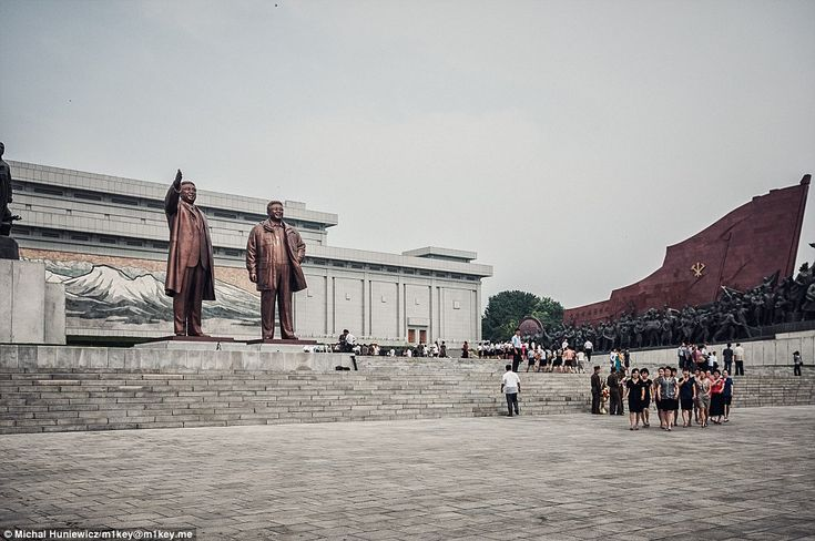 The towering metal statues of North Korea's founding father Kim Il-Sung and King Jong-Il s...