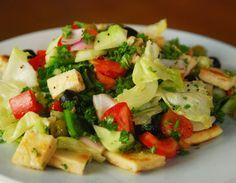 Toasted pita bread, salad vegetables, olives and extra virgin oil mixed to make…