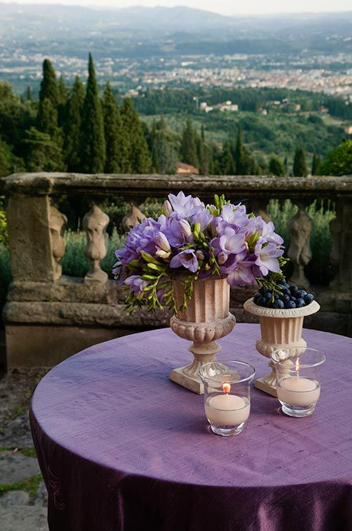 A simple purple table setting overlooks the lush rolling hills of Florence. Megan and Paul had lunch in a place like this in 'The Cornish Knot'. www.vickyadin.co.nz