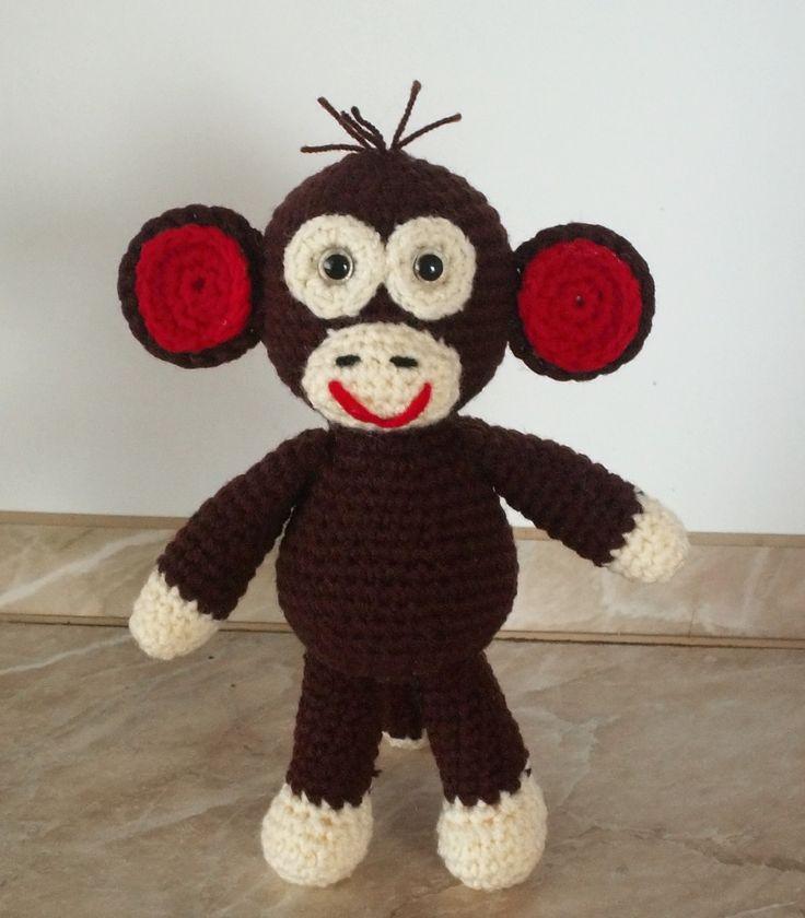 opička je uháčkována z příze Gloria, vyplněná umělým rounem. Má bezpečnostní očka. Je velká asi 20cm.