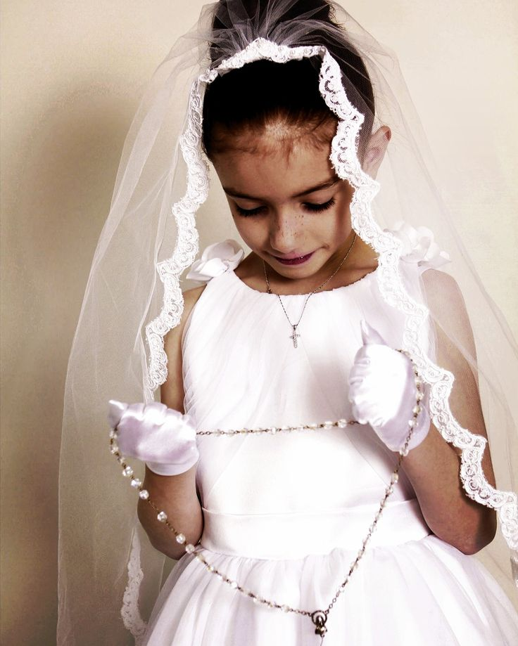 This #angel looks #beautiful in #anjasdream #Alencon #Lace #mantilla #veil = #product #1322.   #holycommunion #princess #angels #rosary #accessories #flowergirl #updo #precious #instaglam #details #crosses #girls #love #specialoccasions #instaphoto
