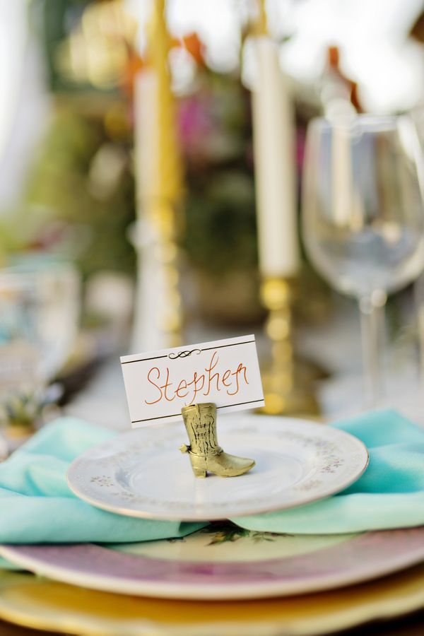 Show guests where to sit with a cute little cowboy boot place card holder! | Southwestern Wedding Inspiration in a Southern Setting | Photographer: Andie Freeman Photography
