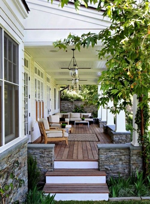 Back porch ideas {The brown wood flooring would be more comfortable than painted wood because people will have dirt on their shoes often, from walking and spending time outdoors and along the creek especially.  The wood will help them be less worried about leaving footprints on white or gray porch floors. wsh}