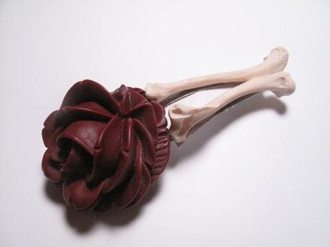 Red resin rose and mink bone barrette.