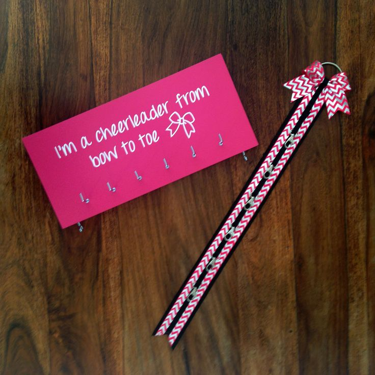 Pink medal holder and pink/silver chevron bow holder set.