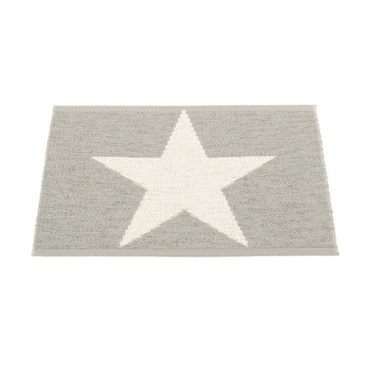 The Pappelina Viggo One mat features a single vanilla star on a warm grey background. Flip the rug over and the design is reversed.  Soft to walk on, this traditionally made plastic mat is ideal for the bathroom, kitchen, utility room, or as a welcoming door mat.  Woven from soft plastic using traditional Swedish techniques, Pappelina rugs can be used in all areas of the home, and even outdoors.  They are reversible, dust and dirt repellent and fully washable.