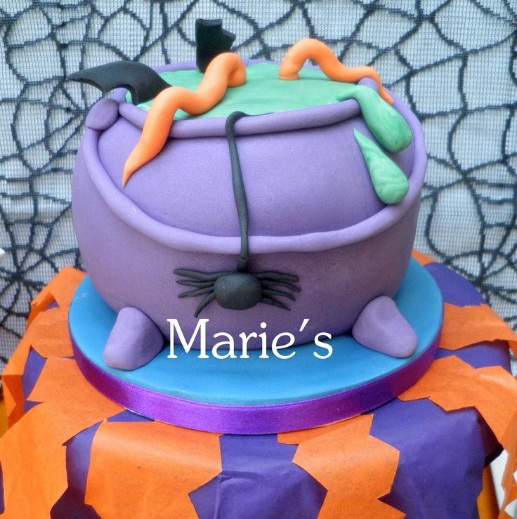 www.facebook.com/Mariescreativecakes  Cauldron cake (it's also green cake inside!)